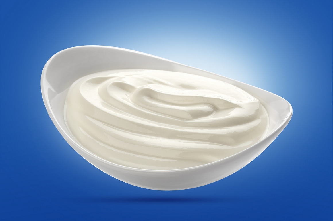 Sour cream isolated on white background