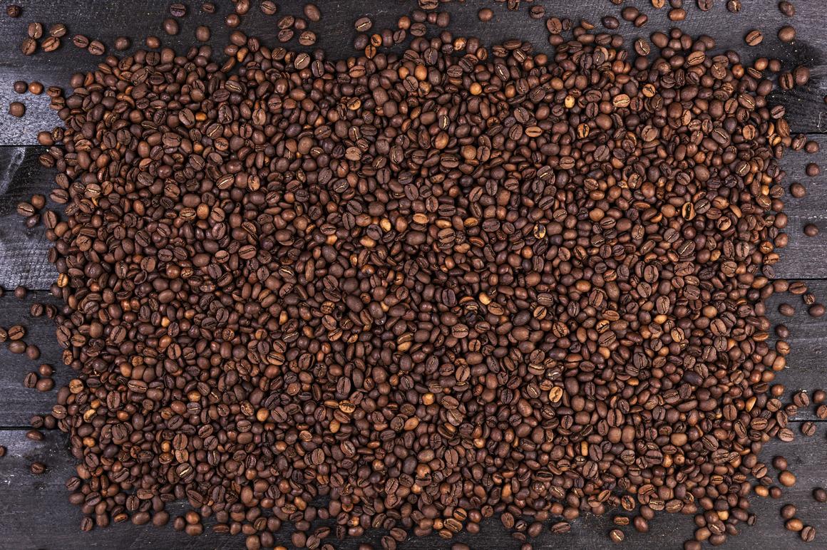 Coffee beans on dark wooden background