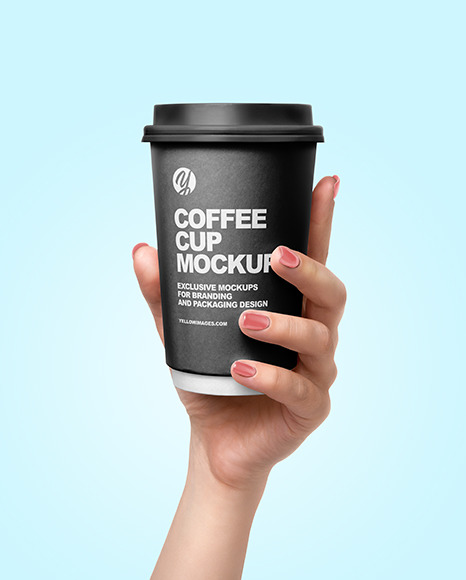 Coffee Cup in a Hand Mockup