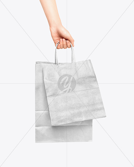 Download Hand w/ Two Paper Bags Mockup Free Mockups