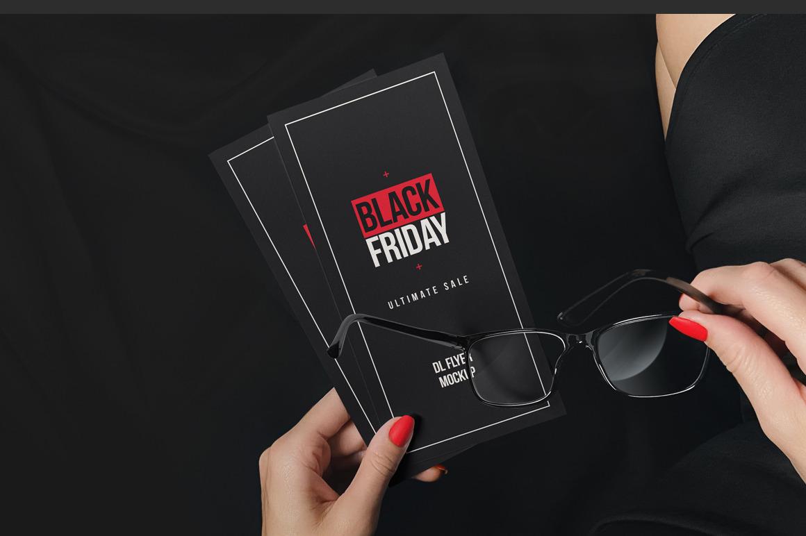 Woman Holding DL Flyer Black Scene Mockup